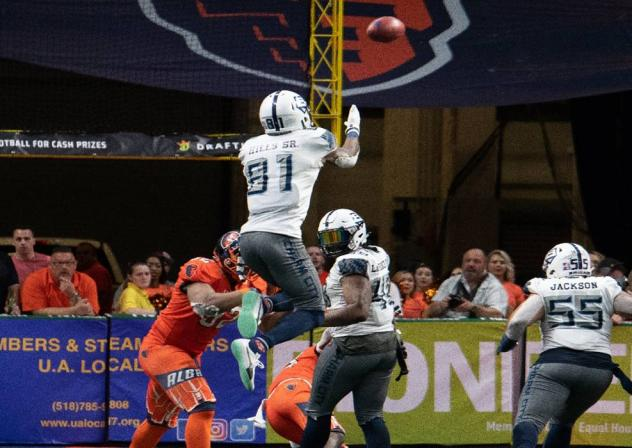 Baltimore Brigade wide receiver Joe Hills leaps high for a ball against the Albany Empire