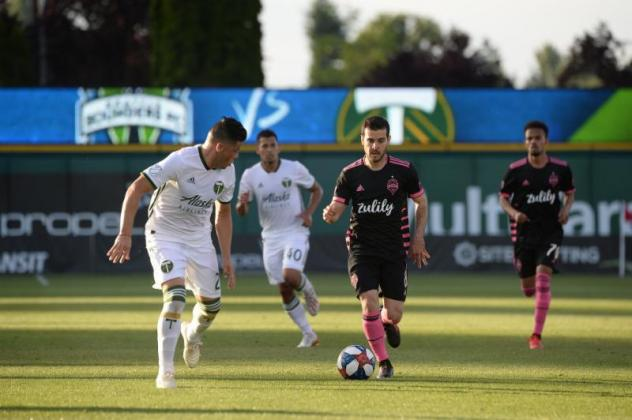 Victor Rodriguez of Seattle Sounders FC with possession vs. the Portland Timbers