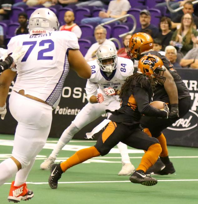 Arizona Rattlers carry the ball against the San Diego Strike Force