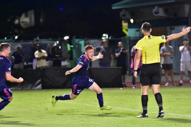 South Georgia Tormenta FC forward Mikie Rowe celebrates his goal against Orlando City B