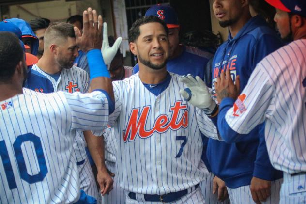 Gregor Blanco celebrates with his Syracuse Mets teammates in the dugout during Sunday's game
