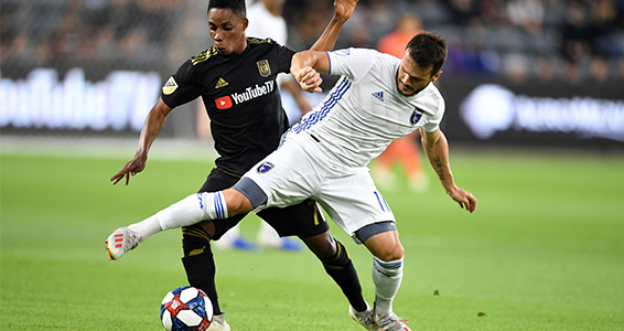 Dan Jose Earthquakes midfielder Vako (right) battles for possession with LAFC's Latif Blessing