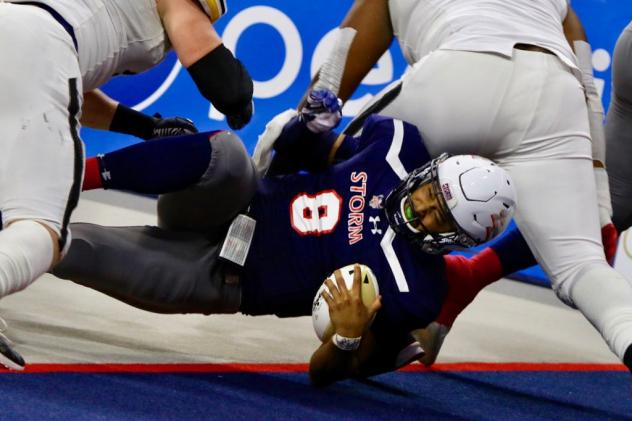 Sioux Falls Storm quarterback Lorenzo Brown dives for the endzone against the Tucson Sugar Skulls