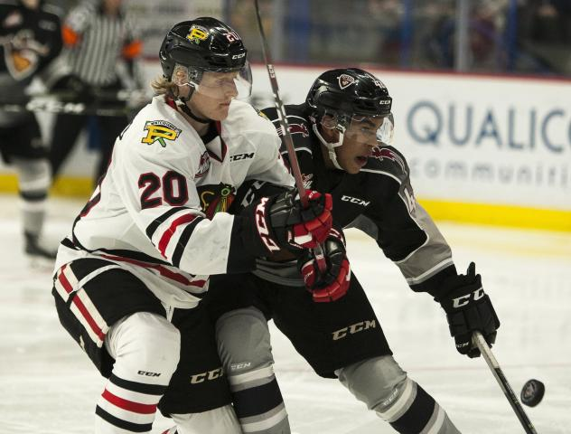 Vancouver Giants centre Justin Sourdif (right) against the Portland Winterhawks