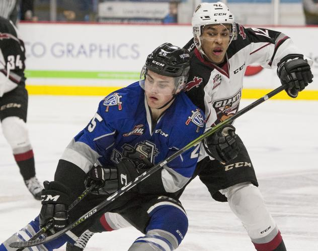 Vancouver Giants forward Justin Sourdif (right)