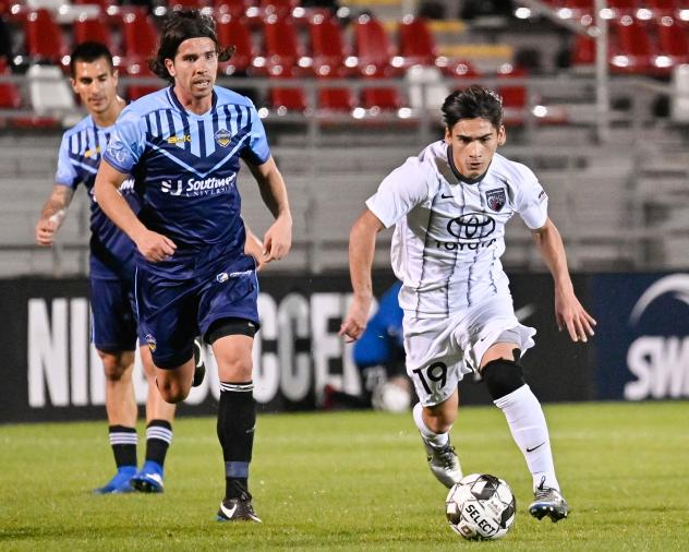 San Antonio FC midfielder Cristian Parano (right) vs. Fresno FC