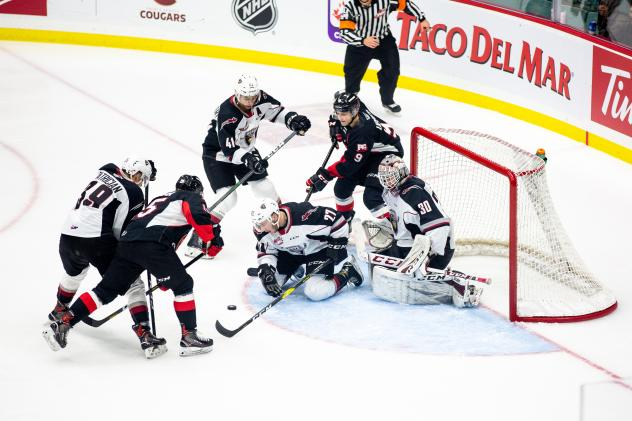 Prince George Cougars battle in front of the Vancouver Giants net