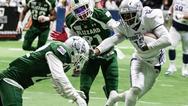 Marques Rodgers of the San Diego Strike Force (right) against the Green Bay Blizzard