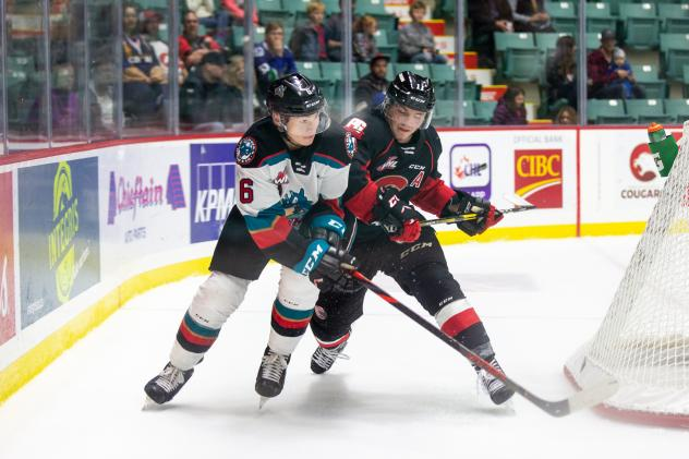 Kelowna Rockets defenceman Cayde Augustine (right) battles the Prince George Cougars
