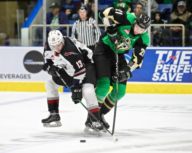 Vancouver Giants left wing Sergei Alkhimov (left) vs. the Prince Albert Raiders