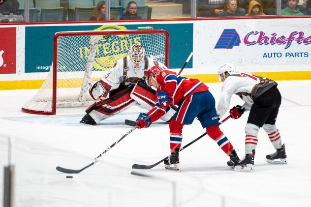 Spokane Chiefs center Bear Hughes skates in on the Prince George Cougars