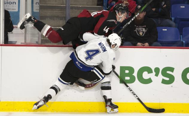 Vancouver Giants defenceman Bowen Byram is tossed into the boards by the Victoria Royals