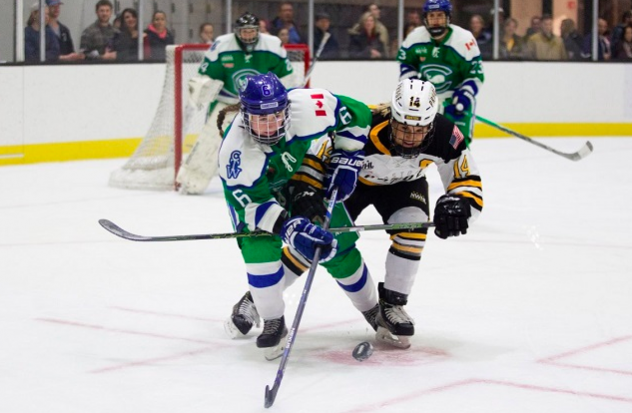 Shannon Doyle of the Connecticut Whale (left) battles for the puck