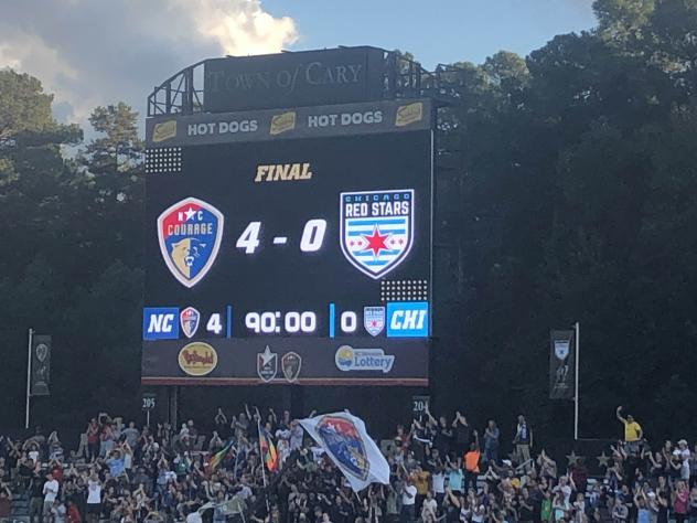 North Carolina Courage fans celebrate the final score at the NWSL Championship Game