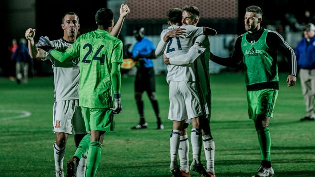 Real Monarchs SLC exchange congratulations after upsetting Phoenix FC in the playoffs