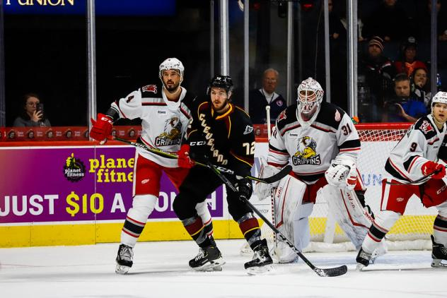 Cleveland Monsters forward Ryan MacInnis (center) sets up in front of the Grand Rapids Griffins' goal