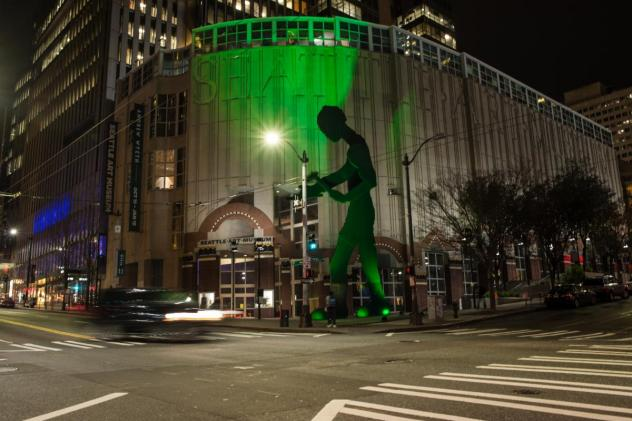 Hammering Man glows Rave Green in support of Seattle Sounders FC