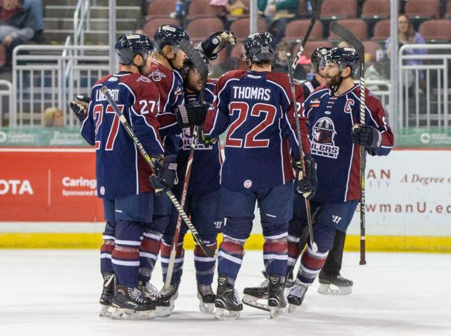Tulsa Oilers Quiet congregate after one of their seven goals against the Wichita Thunder