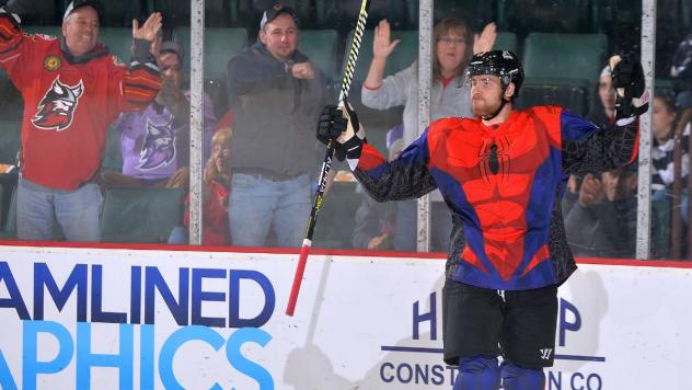Adirondack Thunder, in Spider-Man jerseys, celebrate a goal in front of their fans
