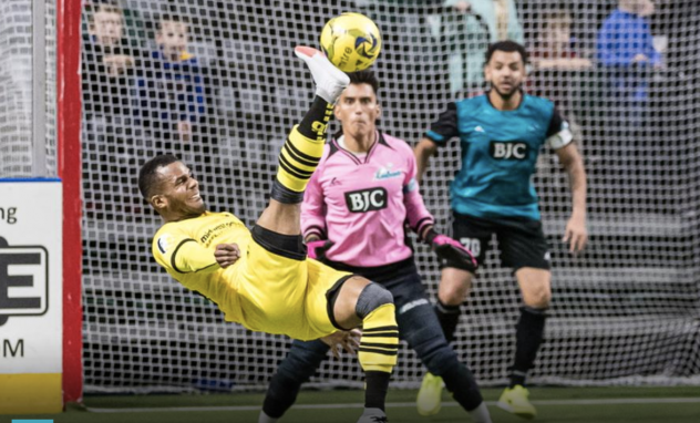 Ian Bennett of the Milwaukee Wave concentrates on a bicycle kick