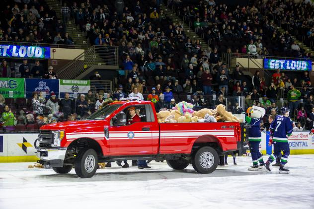 Maine Mariners pick up toys from their Teddy Bear Toss