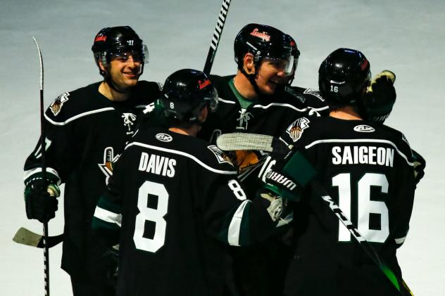 Utah Grizzlies huddle up to celebrate a goal