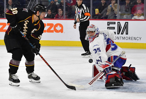 Cleveland Monsters left wing Nathan Gerbe shoots against the Laval Rocket