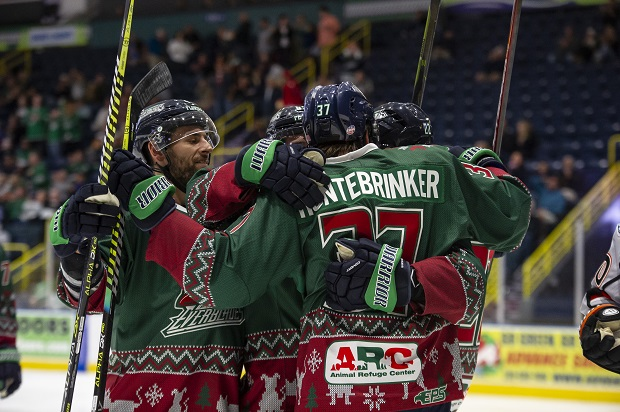 Florida Everblades in their ugly Christmas sweater jerseys