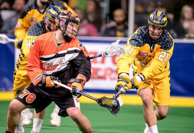 Brendan Bomberry of the Georgia Swarm (right) defends against the Buffalo Bandits