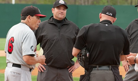 Road Warriors manager Ellie Rodriguez talks with the umpires