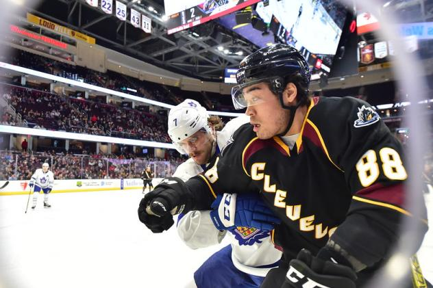 Cleveland Monsters right wing Kole Sherwood (right) vs. the Toronto Marlies