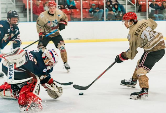 New Jersey Titans forward Mitch Machlitt (right) vs. the Johnstown Tomahawks