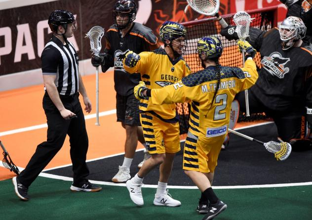 Miles and Lyle Thompson of the Georgia Swarm celebrate against the New England Black Wolves