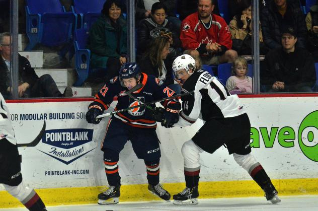 Vancouver Giants centre Eric Florchuk (right) battles the Kamloops Blazers