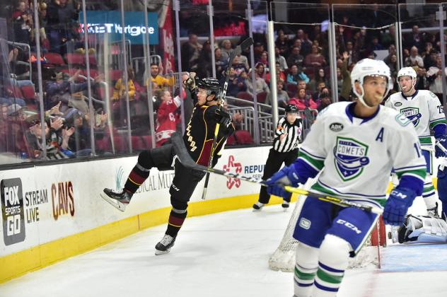 Cleveland Monsters react after a goal against the Utica Comets