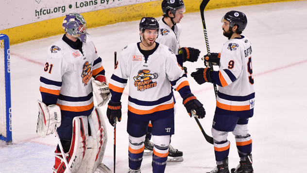 Greenville Swamp Rabbits exchange congratulations