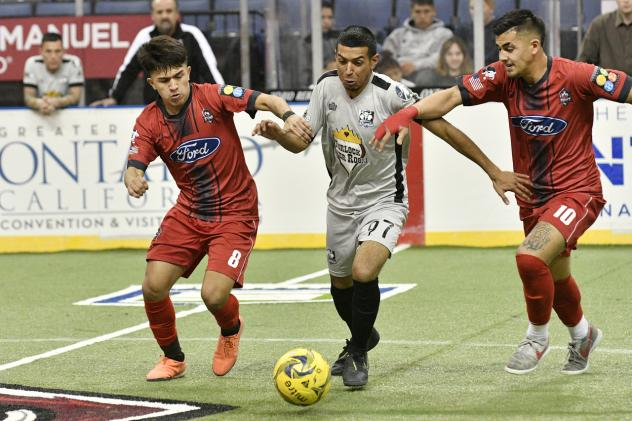 Ontario Fury midfielders Jesus Pacheco (left) and Justin Stinson (right) battle the Turlock Cal Express