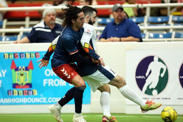 Alex Caceres of the Tacoma Stars fends off a Mesquite Outlaws defender