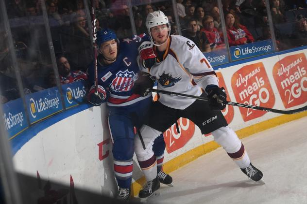 Cleveland Monsters left wing Paul Bittner (right) vs. the Rochester Americans