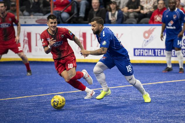 Ontario Fury midfielder Justin Stinson (left) defends against the Kansas City Comets