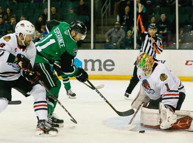 Joel L'Esperance of the Texas Stars eyes the puck against the Rockford IceHogs