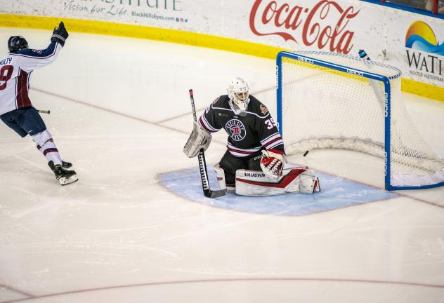 Ian McNulty of the Tulsa Oilers scores against the Rapid City Rush