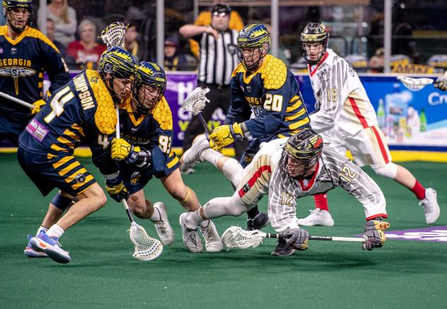 Georgia Swarm and Philadelphia Wings battle for a loose ball