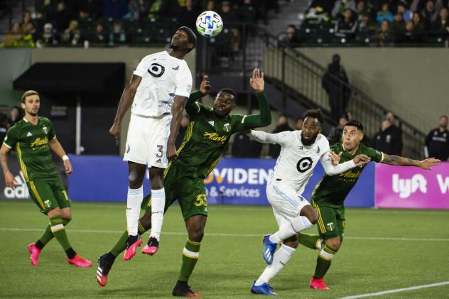 Minnesota United FC defender Ike Opara goes high for a ball
