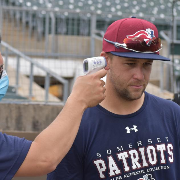 Scott Kelly of the Somerset Patriots gets his temperature taken