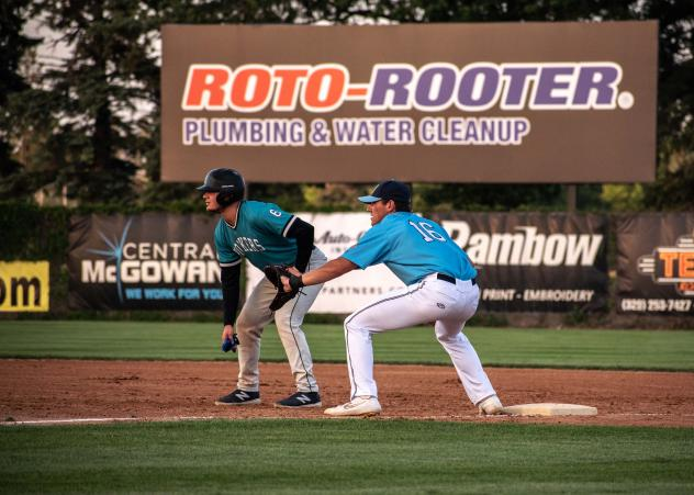 St. Cloud Rox first baseman Jack Kelly (right) keeps a Rochester Honkers base runner close