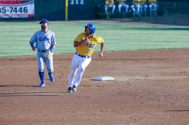 Damek Tomscha of the Sioux Falls Canaries rounds second against the St. Paul Saints
