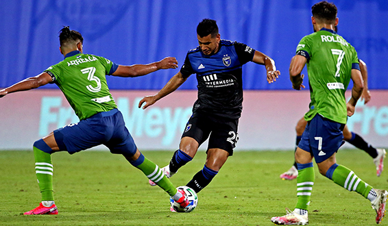 Andy Rios of the San Jose Earthquakes dribbles between two Seattle ...
