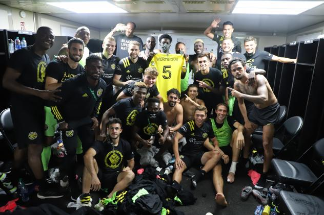 Columbus Crew SC holds Vito Wormgoor's jersey after beating the New York Red Bulls