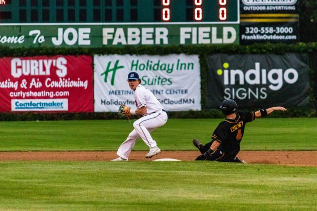 Jack Walker of the St. Cloud Rox trying to turn two